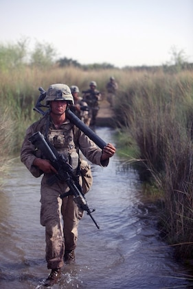 "Marines with 3rd Battalion, 7th Marine Regiment patrol through Sangin District during their deployment to Helmand province, Afghanistan in 2010. Chief Warrant Officer 4 Matthew Carpenter, the infantry weapons officer, ""Gunner,"" with Regimental Combat Team 7, joined the Marine Corps in 1989 and has deployed thirteen times including five times to Iraq and twice to Afghanistan."