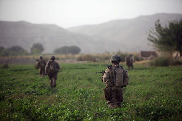 "Marines with 3rd Battalion, 7th Marine Regiment patrol through Sangin District during their deployment to Helmand province, Afghanistan in 2010. Chief Warrant Officer 4 Matthew Carpenter, the infantry weapons officer, ""Gunner,"" with Regimental Combat Team 7 has been on seven combat deployments to include five to Iraq and two to Afghanistan."