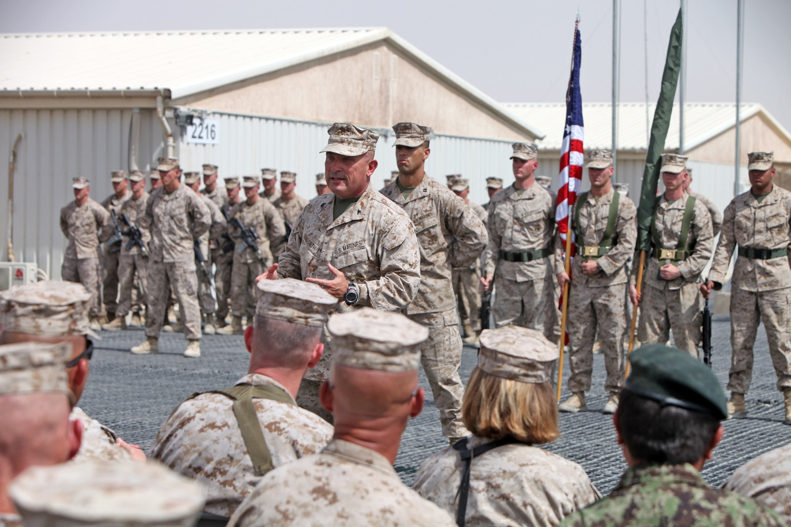 "Col. A. E. ""Sparky"" Renforth, Regimental Combat Team 7 commanding officer, talks to Marines and coalition forces during the casing of the colors ceremony here, July 31, 2013. ""I say all the time, 'It's amazing what you can do when you don't care who gets the credit,'"" Renforth said. ""That's what our Marines have lived by, and they all know that they made a difference."""