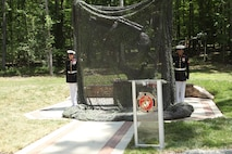 Marine unveil the Staff Sgt. Reckless monument in the Semper Fidelis Memorial Park at the National Museum of the Marine Corps on July 26, 2013. Reckless was a warhorse who fought alongside the Marines in the Korean War. (U.S. Marine Corps photo by Sgt. Marionne T. Mangrum)