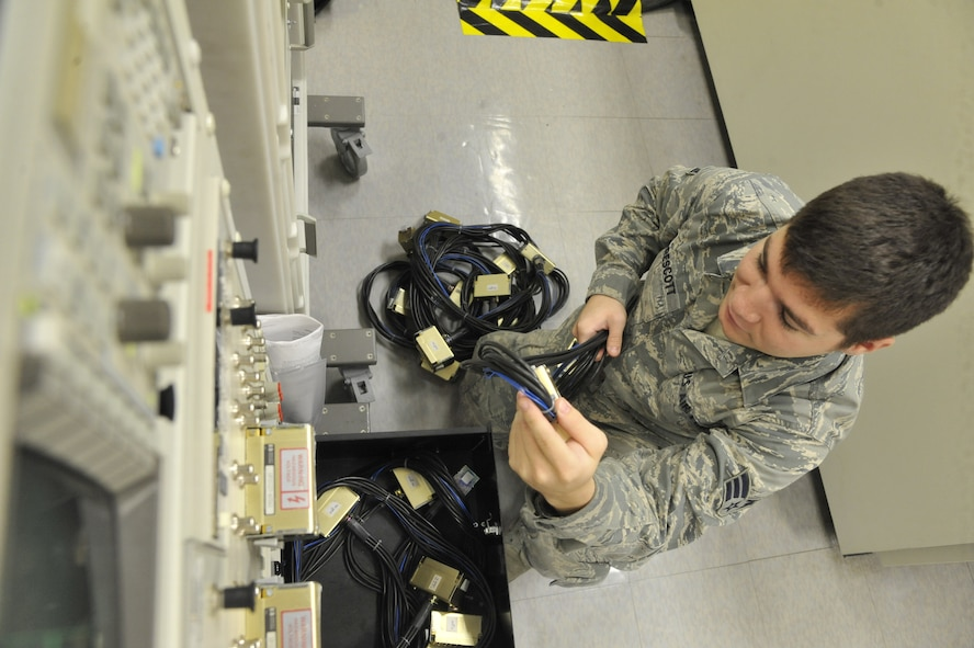 Senior Airman Christopher Prescott, 509th Maintenance Squadron avionics back shop team member, verifies inventory on portable calibration equipment at Whiteman Air Force Base, Mo., July 25, 2013. The avionics team performs semi-annual inspections to ensure no equipment is missing or damaged, and they recalibrate equipment every 180 days to verify the test station's serviceability. (U.S. Air Force photo by Airman 1st Class Keenan Berry/Released)