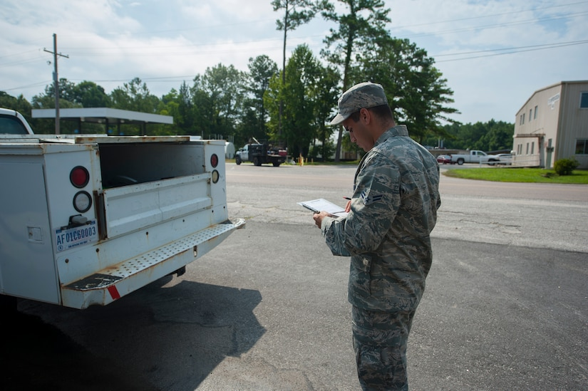 Airman 1st Class Christopher Castro, 628th Logistics Readiness Squadron Petroleum Oil and Lubricants fuels specialist, records vehicle information before servicing a vehicle July 25, 2013, at Joint Base Charleston- Weapons Station, S.C. In one month, the 628th LRS POL provided more than1,600 gallons of gas to 80 vehicles on the Weapons Station. POL fuels supplies JB Charleston vehicles with fuel, including rail operations, cranes on Wharf Alpha to offload ships, port operations on the water, the 628th Security Forces Squadron and the U.S. Coast Guard. The 628th LRS has been providing this service since October 2010. A new service station is under construction at the Weapons Station and is scheduled to open later this year. (U.S. Air Force photo/Senior Airman Ashlee Galloway)