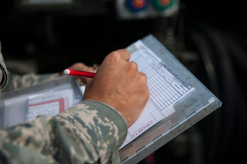 Airman 1st Class Christopher Castro, 628th Logistics Readiness Squadron Petroleum Oil and Lubricants fuels specialist, records receipt information after servicing a vehicle July 25, 2013, at Joint Base Charleston- Weapons Station, S.C. POL fuels supplies JB Charleston vehicles with fuel, including rail operations, cranes on Wharf Alpha to offload ships, port operations on the water, the 628th Security Forces Squadron and the U.S. Coast Guard. The 628th LRS has been providing this service since October 2010. A new service station is under construction at the Weapons Station and is scheduled to open later this year. (U.S. Air Force photo/Senior Airman Ashlee Galloway)