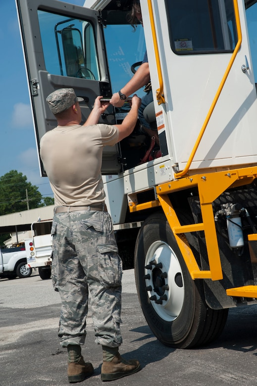 Senior Airman Mark Roth, 628th Logistics Readiness Squadron Petroleum Oil and Lubricants fuels specialist, gets a customer's signature July 25, 2013, at Joint Base Charleston- Weapons Station, S.C. In one month, the 628th LRS POL fuels provided more than 1,600 gallons of gas to 80 vehicles on the Weapons Station. The 628th LRS has been providing this service since October 2010. A new service station is under construction at the Weapons Station and is scheduled to open later this year.  (U.S. Air Force photo/Senior Airman Ashlee Galloway)