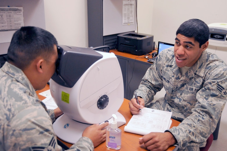 130725-Z-HC784-027 – Senior Airman Aalona Chandler, a member of the 127th Medical Group, records the results of an Airman's vision test at Selfridge Air National Guard Base, July 25, 2013. The 127th Medical Group is charged with maintaining the medical readiness of nearly 1,700 Citizen-Airmen in the Michigan Air National Guard. (U.S. Air National Guard photo by John S. Swanson/Released)