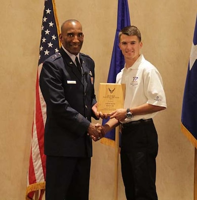 Seventeen-year-old Austin McCoy accepts his award for Air Force Reserve Command's Youth of the Year 2013 from Maj. Gen. Alfred J. Stewart, commander, Air Force Personnel Center, Joint Base San Antonio-Randolph, Texas. Austin received the award for his extensive volunteer work, philanthropic aspirations and involvement in activities as an Eagle Scout. (Courtesy photo)