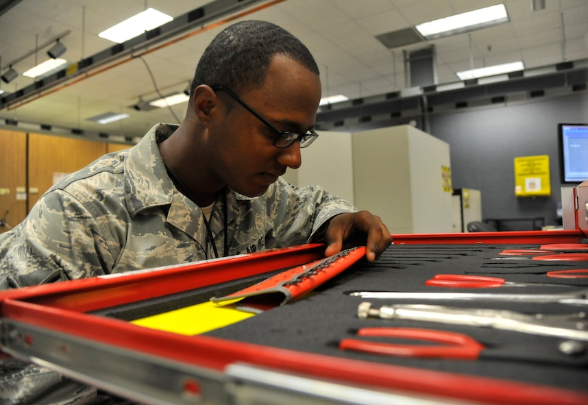 Airman 1st Class Michael Touchette, 509th Maintenance Squadron avionics back shop team member, inspects a tap and die set at Whiteman Air Force Base, Mo., July 25, 2013. The tap and die set must be inspected to ensure there are no damaged or missing tools. These tools are used to rethread screws on line replaceable units and to prevent personality modules threads from stripping. (U.S. Air Force photo by Airman 1st Class Keenan Berry/Released)