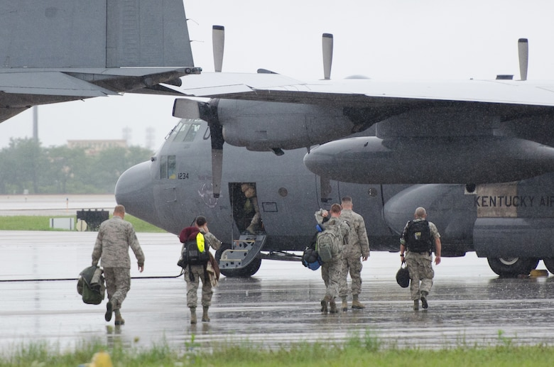 Airmen from the 123rd Airlift Wing board a C-130 Hercules aircraft at the Kentucky Air National Guard Base in Louisville, Ky., July 6, 2013, for a deployment to Puerto Rico in support of Operation Coronet Oak. The mission provides theater airlift services for U.S. military and government operations across the Caribbean and Central and South America. (U.S. Air National Guard photo by Airman Joshua Horton)