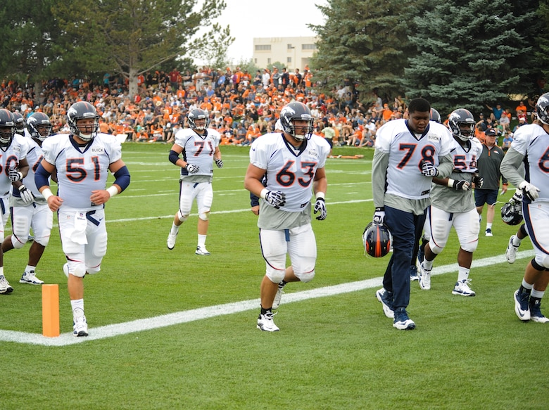 Benjamin Garland, Denver Broncos offensive guard, 63, runs to the next drill with the rest of his offensive line members during a Broncos training camp practice July 29, 2013, at the Broncos training facility, Englewood, Colo. Garland spent last season on the Broncos practice squad and transitioned from defensive tackle to offensive guard before the Broncos 2013 mini-camp. Garland is also a first lieutenant for the 140th Wing, Colorado Air National Guard, and served his annual commitment during the early part of 2013. (U.S. Air Force photo by Staff Sgt. Christopher Gross/Released)