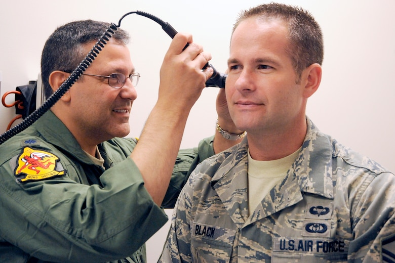 130725-Z-HC784-041 – Lt. Col. Dr. Ralph Torres, a physician with the 127th Medical Group, performs an ear examination on Master Sgt. Kyle Black at Selfridge Air National Guard Base, July 25, 2013. The 127th Medical Group is charged with maintaining the medical readiness of nearly 1,700 Citizen-Airmen in the Michigan Air National Guard. (U.S. Air National Guard photo by John S. Swanson/Released)