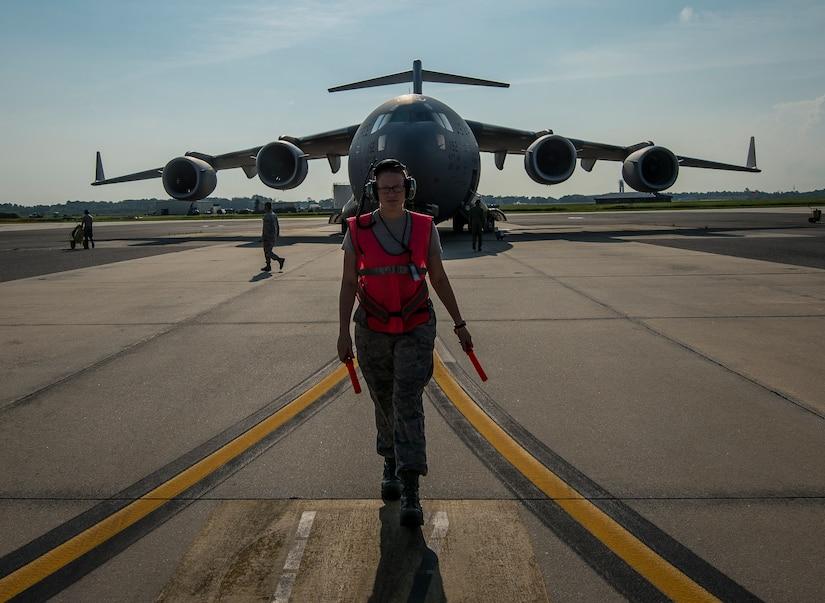 Senior Airman Brandi Barentine, 437th Aircraft Maintenance Squadron crew chief, walks to her designated area to begin marshaling a C-17 Globemaster III July, 30, 2013, at Joint Base Charleston – Air Base, S.C. (U.S. Air Force photo/ Senior Airman Dennis Sloan)
