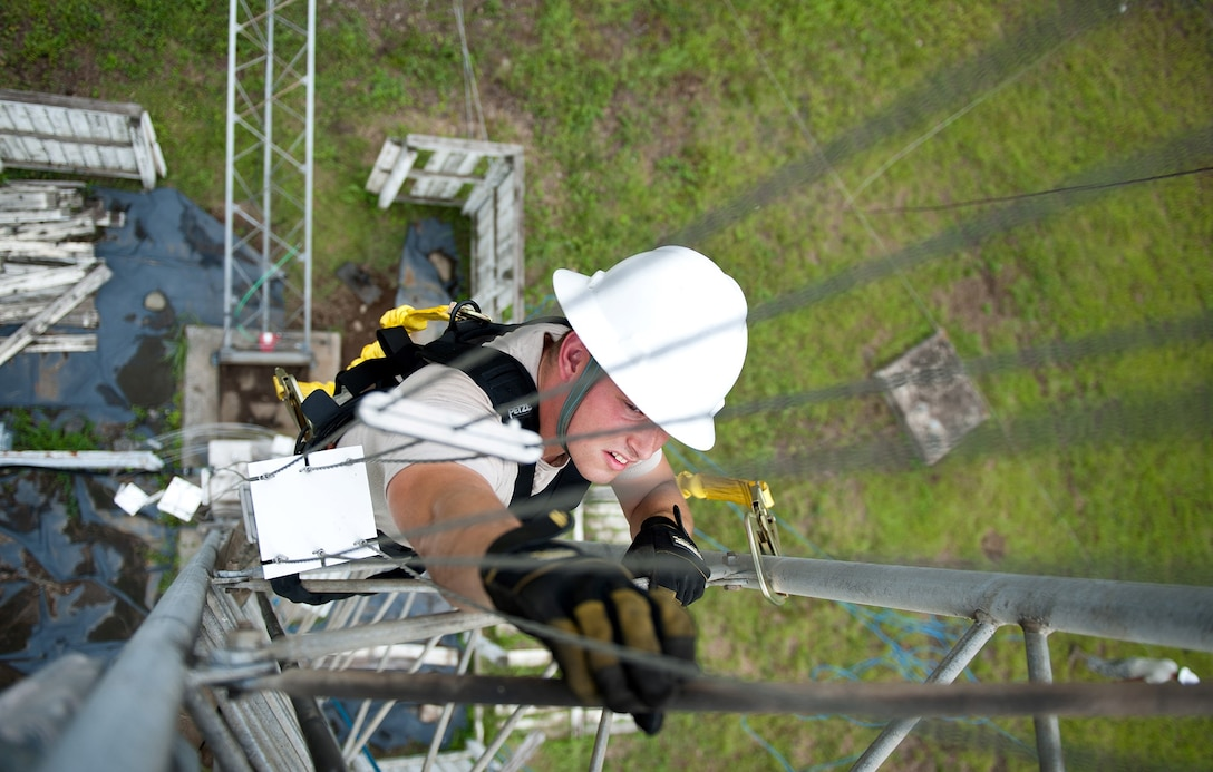 Airman 1st Class Mike Turland climbs the stand to a rotatable log periodic antenna during scheduled maintenance July 26, 2013, at the Tokorozawa Communications Site, Japan. Turland wears a safety harness to prevent the possibility of falling and ensures he has three points of contact throughout the climb. Turland is a cable and antenna maintenance technician assigned to the 374th Communications Squadron. (U.S. Air Force photo/Senior Airman Cody H. Ramirez)