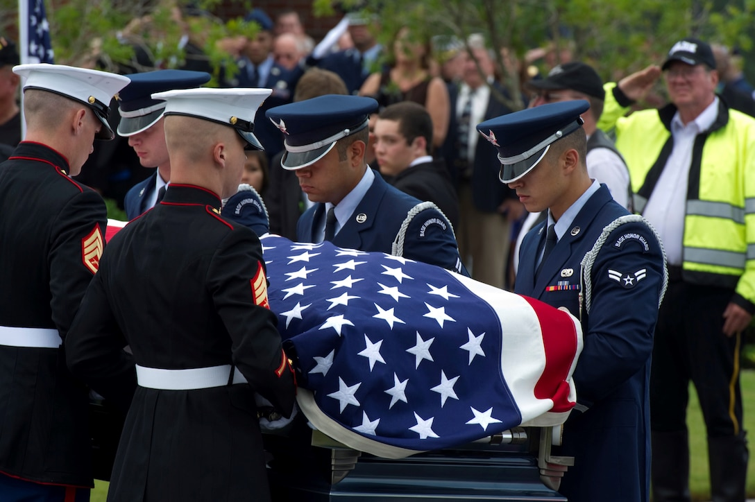 "Pallbearers, made up of Airmen and Marines, carry the casket of retired U.S. Air Force Col. George ""Bud"" Day during his funeral service at Barrancas National Cemetery on Naval Air Station Pensacola, Fla., Aug. 1, 2013. Day, a Medal of Honor recipient and combat pilot with service in World War II, Korea and Vietnam, passed away July 27 at the age of 88. (U.S. Air Force Photo/Staff Sgt. John Bainter)"