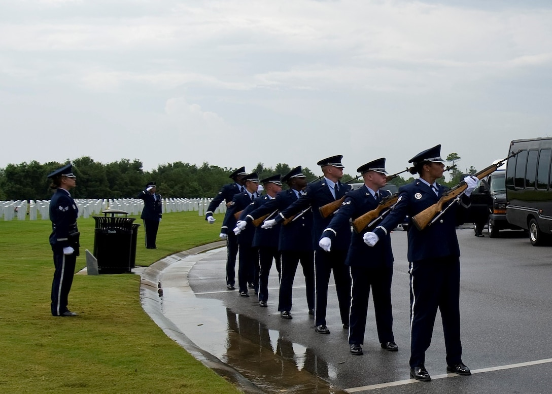 "The Hurlburt Field Honor Guard firing team performs a 21-gun salute at the funeral service for retired U.S. Air Force Col. George ""Bud"" Day at Barrancas National Cemetery on Naval Air Station Pensacola, Fla., Aug. 1, 2013. Day, a Medal of Honor recipient and combat pilot with service in World War II, Korea and Vietnam, passed away July 27 at the age of 88. (U.S. Air Force Photo/Staff Sgt. John Bainter)"