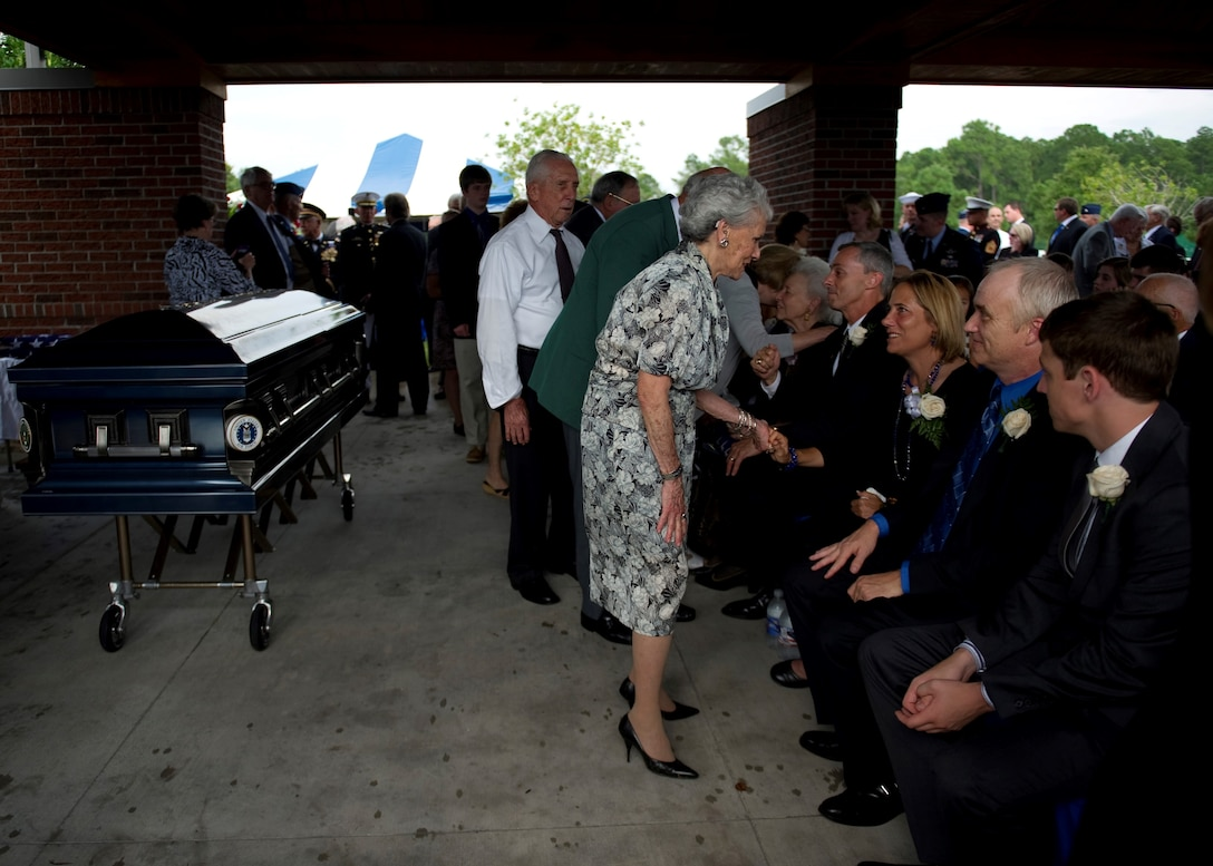 "Guests pay their final respects to retired U.S. Air Force Col. George ""Bud"" Day's family upon the conclusion of his funeral service at Barrancas National Cemetery on Naval Air Station Pensacola, Fla., Aug. 1, 2013. Day, a Medal of Honor recipient and combat pilot with service in World War II, Korea and Vietnam, passed away July 27 at the age of 88. (U.S. Air Force Photo/Staff Sgt. John Bainter)"