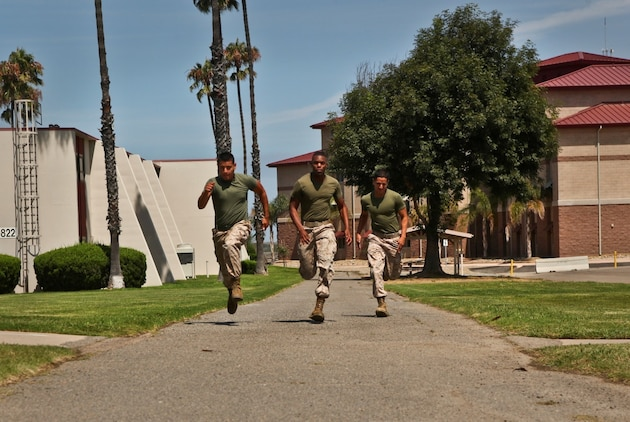 Lance Cpl. Albert Perez III (left), conducts combat-oriented physical training with Lance Cpl. Anthony Hendrix (center) and Pfc. Diego Retamozo, all administration specialists, Command Element, 15th Marine Expeditionary Unit, aboard Camp Pendleton, Calif., Aug. 1.  The Marines are preparing for the Combat Fitness Test, an annual physical fitness test that challenges Marines' physical and mental readiness for the rigors of today's combat operations. Hendrix, 21, McLeansville, N.C. ; Retamozo, 20, is from Perth Amboy, N.J., and Perez, 21, is from Los Angeles. (U.S. Marine Corps Photo by Cpl. Emmanuel Ramos/Released)