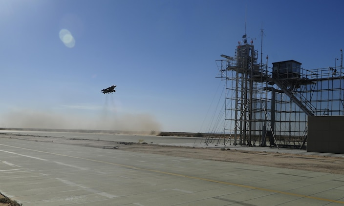 One of two VMA-214 AV-8B harriers reviews vertical landing procedures with the on-site systems tower to ensure mission readiness.  The field carrier imitation dock at Site 3-9, also known as AUX-II, 30 minutes out of Canon Air Defense Complex, serves as the ideal staging ground for Marine Attack Squadron 214 pilots to complete pre-deployment ship-based vertical landing certification.
