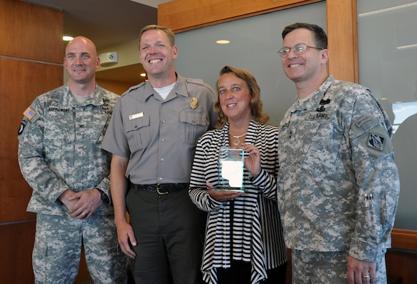 Maj. Gen. John Peabody (right), Mississippi Valley Division commander, presented a National Water Safety award to Carma Hanson, Grand Forks Safe Kids coordinator. Also in the photo is Col. Dan Koprowski (left), St. Paul District commander, and the person who nominated Hanson for this award, Scott Tichy, St. Paul District park ranger.