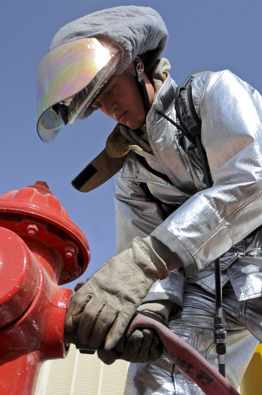 U.S. Air Force Airman 1st Class Alex Kolnberger, 380th Civil Engineer Squadron Fire Department handlineman, connects a hose to a fire hydrant at an undisclosed location in Southwest Asia Aug. 1, 2013. During an exercise, Kolnberger's team was required to show the capability to swiftly deploy handline hoses. Kolnberger calls South St. Paul, Minn., home and is deployed from Eielson Air Force Base, Alaska. (U.S. Air Force photo by Staff Sgt. Jacob Morgan)
