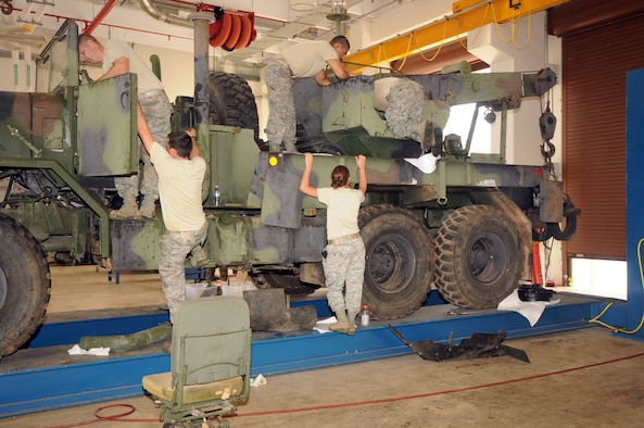 Airmen from the 200th RED HORSE Squadron Ohio Air National Guard, restore an M-900 Series Wrecker August 1, 2013, on Andersen Air Force Base, Guam. More than 40 Airmen helped Andersen with services, vehicle maintenance and supply during a temporary duty assignment here. (U.S. Air Force photo by Airman 1st Class Amanda Morris/Released)