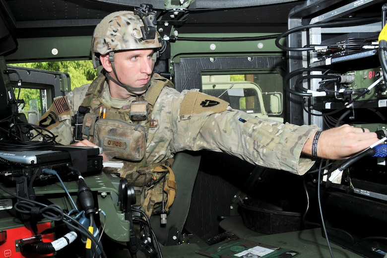 Tech. Sgt. Ryan Erickson, 147th Reconnaissance Wing member, adjusts a radio in a HUMVEE at Ellington Field Joint Reserve Base in Houston.