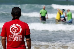 Exceptional Family Member Program members and volunteers with the Orange County Best Day Foundation spent the day surfing, body boarding and Kayaking in an effort to build self-esteem and confidence in children during the Best Beach Day Event at the Del Mar Beach here Aug. 3.