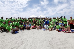 Exceptional Family Members Program members and volunteers with the Orange County Best Day Foundation gather for a group photo after spending the day surfing, body boarding and Kayaking in an effort to build self-esteem and confidence in children at the Del Mar Beach here Aug. 3.