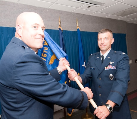 Lt. Col. Tory Saxe (right) receives the 176th Maintenance Group command flag from the 176th Wing commander, Brig. Gen. Donald S. Wenke, at an Aug. 3, 2013 assumption-of-command ceremony at Joint Base Elmendorf-Richardon, Alaska. National Guard photo by Capt. John Callahan.