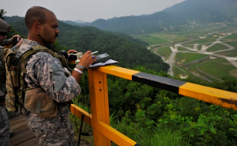 Staff Sgt. Alexander Hardy, 604th Air Support Operations Squadron joint terminal attack controller, maps out a target during live close air support training at Rodriguez Range, Republic of Korea, June 27, 2013. JTACs like Hardy are responsible for communicating with pilots and advising ground-force commanders on where and how to attack enemy forces. (U.S. Air Force photo/Senior Airman Siuta B. Ika)