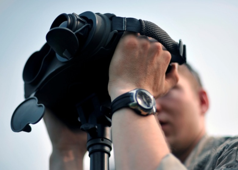 Airman 1st Class Nick Hurren, 604th Air Support Operations Squadron joint terminal attack controller, looks through a set of rangefinders during live close air support training at Rodriguez Range, Republic of Korea, June 27, 2013. Because of the impact they can have on any battlefield, JTACs maintain a rigorous training schedule in which they utilize the many tools of their trade. (U.S. Air Force photo/Senior Airman Siuta B. Ika)
