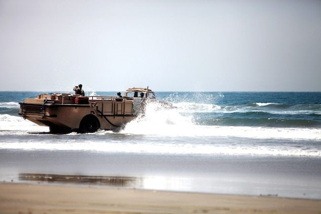 A Light Amphibious Resupply Craft storms the beach when Combat Logistics Battalion 7, Combat Logistics Regiment 1, 1st Marine Logistics Group, conducted an embarkation exercise aboard Camp Pendleton, Calif., July 18, 2013. This is the first time in a decade the battalion, which is based out of Marine Corps Air Ground Combat Center in Twentynine Palms, Calif., has conducted a battalion FEX outside of Twentynine Palms.