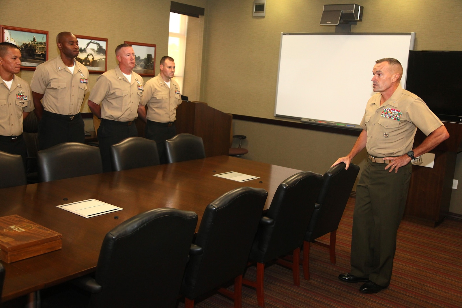 Brigadier Gen. Vincent A. Coglianese, the commanding general of 1st Marine Logistics Group, addresses sailors who are selected for promotion to Chief Petty Officer aboard Camp Pendleton, Calif., Aug. 2, 2013. Out of the 54 possible candidates, only 14 sailors were selected for promotion.