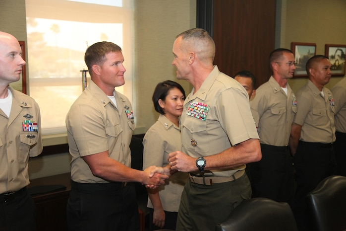 Brigadier Gen. Vincent A. Coglianese, the commanding general of 1st Marine Logistics Group, shakes hands with sailors who are selected for promotion to Chief Petty Officer aboard Camp Pendleton, Calif., Aug. 2, 2013. Out of the 54 possible candidates, only 14 sailors were selected for promotion.