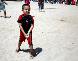 Jayden, a 4-year-old, prepared to compete in a water balloon-throwing contest during the Headquarters and Support Battalion Family Day on Del Mar Beach Resort here August 2. Battalion Family Day is an event to promote camaraderie and bonding for the service members and their families. Peet is the son of Staff Sgt. Natalie Peet.