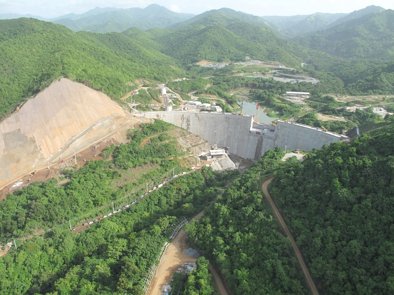 Portugués Dam (looking upstream) now fills the river valley as it nears completion near Ponce, Puerto Rico. Construction is expected to wrap up by the end of the year, with operational testing taking place for most of 2014.