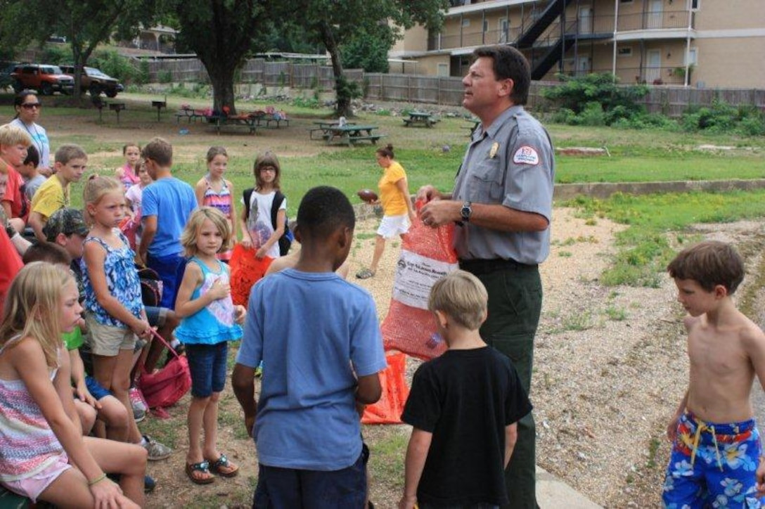 Swim Camp Photo - Brian Westfall, U.S. Army Corps of Engineers Natural Resource Specialist/ Ranger teaches youth about water safety.  The camp is geared towards youth aged 5-13 years, with approximately 100 youth having enrolled this year. Through this partnership, the educational camp includes a Fun Day at Arc Isle, a public park at Lake Hamilton. This Fun Day at Arc Isle is one of the educational field trips which gives the youth the opportunity to swim in Lake Hamilton.
