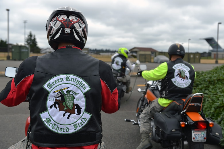 Airman 1st Class Orrin Fenwick, 62nd Aircraft Maintenance Squadron crew chief and member of the Green Knights Military Motorcycle Club Chapter 3, follows fellow members during a ride Aug. 1, 2013 at Joint Base Lewis-McChord, Wash. Originally established in 2000 to help promote motorcycle safety and fight for rider's rights, GKMMC Chapter 3 is one of the first established chapters of 113 chapters at different U.S. military bases worldwide. (U.S. Air Force photo/Airman 1st Class Jacob Jimenez)