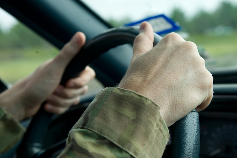 An Airman prepares to negotiate through a driving course as part of the Combat Aviation Advisor Military Qualification Skills Course at Eglin Range, Fla., June 18, 2013.  Airmen practiced shuffle-steering, a tactic where the drive shuffles the steering wheel, instead of the traditional hand-over-hand method, for better handling and to prevent injury to the arms in case the airbag deploys due to a collision.  (U.S. Air Force photo by Airman 1st Class Benjamin Kim)