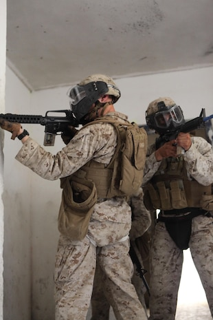 U.S. Marines with Company E, Black Sea Rotational Force 13, clear a room using simulation rounds during close quarters battle drills during Exercise Noble Shirley 13 aboard Camp Adam, Israel, July 10, 2013. The purpose of Noble Shirley 13 is to improve interoperability, understanding and cooperation between the IDF and U.S. Marines.  (U.S. Marine Corps photo by Staff Sgt. David Rakes, Sr./released)