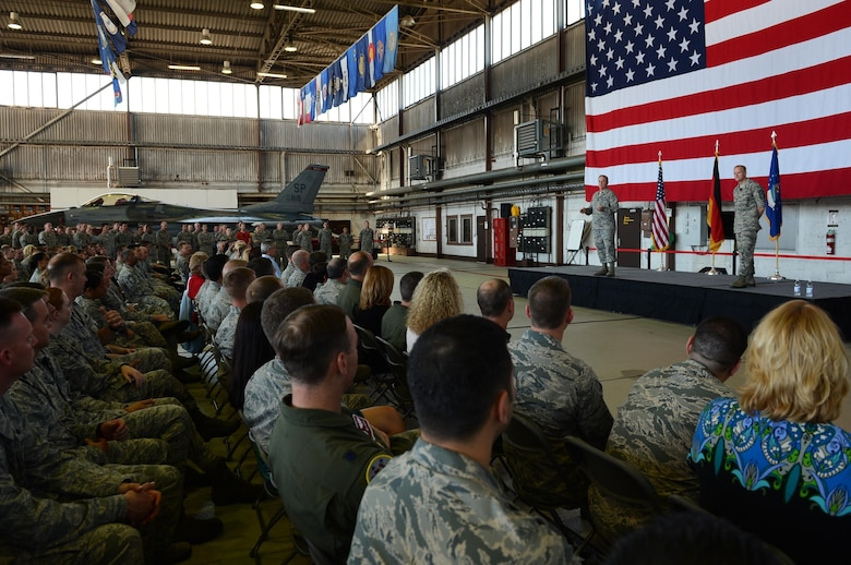Air Force Chief of Staff Gen. Mark A. Welsh III and Chief Master Sgt. of the Air Force James Cody stand center stage in Hangar 1, addressing Airmen about Air Force issues during an Airman's call Aug. 1, 2013. The senior leaders visited the base to thank Airmen and their families for their service and dedication, as well as address current challenges facing the Air Force.