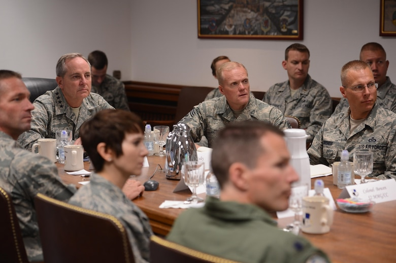 Air Force Chief of Staff Gen. Mark A. Welsh III and Chief Master Sgt. of the Air Force James Cody receive a mission brief here Aug. 1. During their visit, Welsh and Cody had lunch with Airmen at the Mosel Dining Hall and hosted an Airman's call to thank Airmen and their families for their service and dedication, as well as address current challenges facing the Air Force.
