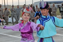 Members of the Mongolian Military Music and Dance Academic Ensemble perform traditional dances during the Mongolian culture night at Exercise Khaan Quest in Five Hills Training Area, Mongolia, August 4, 2013. Khaan Quest is an annual multinational exercise sponsored by the U.S. and Mongolia, and it is designed to strengthen the capabilities of U.S., Mongolian and other nations' forces in international peace support operations.(U.S. Marine Corps Photo by Sgt John M. Ewald/released)