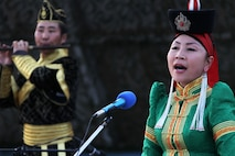 """A member of the Mongolian Military Music and Dance Academic Ensemble performs the traditional """"long song"""" during the Mongolian culture night at Exercise Khaan Quest in Five Hills Training Area, Mongolia, August 4, 2013. Khaan Quest is an annual multinational exercise sponsored by the U.S. and Mongolia, and it is designed to strengthen the capabilities of U.S., Mongolian and other nations' forces in international peace support operations.(U.S. Marine Corps Photo by Sgt John M. Ewald/released)"""