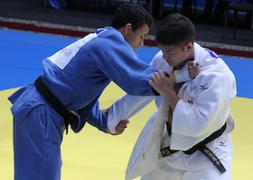 Air Force Captain Trevor Mallo (Kadena AFB, Japan) works for position against A. Silva from Brazil at the 2013 CISM World Military Judo Championship in Astana, Kazakhstan 30 Jun to 7 July.