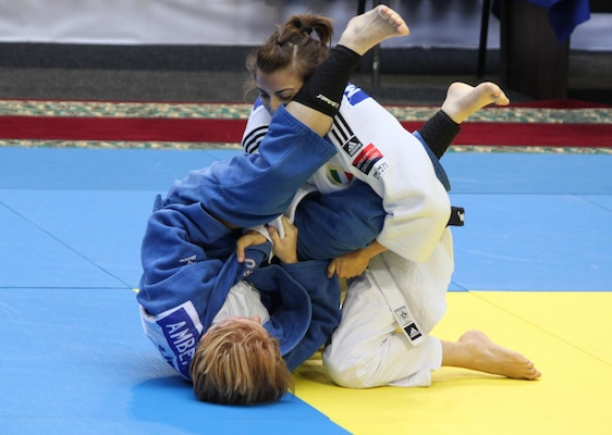 CPT Amber Jones (Missouri National Guard) (left) attempts an arm bar of her opponent at the 2013 CISM World Military Judo Championship in Astana, Kazakhstan 30 Jun to 7 July.