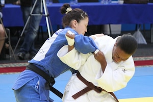 Army 2LT Danielle Smith of the Georgia National Guard attempts a throw of her opponent at the 2013 CISM World Military Judo Championship in Astana, Kazakhstan 30 Jun to 7 July.