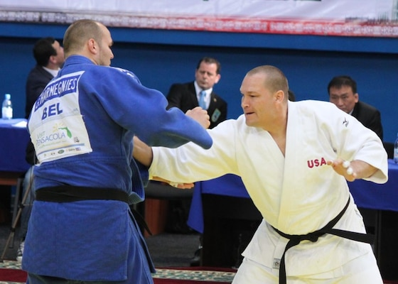 SFC Jeff Deickmann grabs for his opponent from Belgium at the 2013 CISM World Military Judo Championship in Astana, Kazakhstan 30 Jun to 7 July.