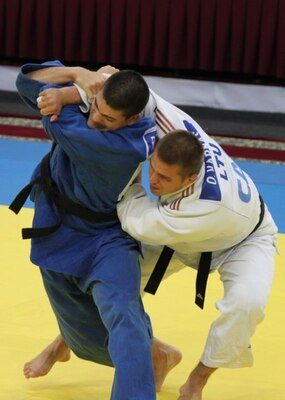 Air Force 1st Lt. Akira Nervik attempts to throw his opponent from Lithuania at the 2013 CISM World Military Judo Championship in Astana, Kazakhstan 30 Jun to 7 July.
