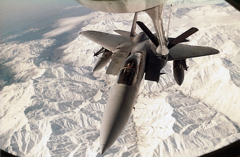 A KC-135 Stratotanker refuels an F-15 over the Turkey-Iraq border during Operation Desert Storm.  The KC-135 is ideal for aerial refueling because it is jet powered, which allows it to reach and maintain a speed at which a fighter can be refueled.  (Courtesy photo)