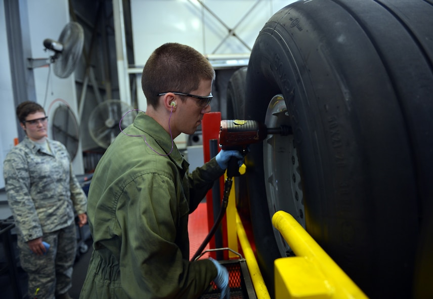 Staff Sgt. Christopher Hirsch, 62nd Maintenance Squadron aerospace maintenance journeyman, removes wheel bolts and studs from a C-17 Globemaster III wheel assembly Aug. 1, 2013, at Joint Base Lewis-McChord, Wash. Wheel and tire technicians maintain tire assemblies on 48 of McChord Field's permanently assigned aircraft, equating to roughly 1,300 maintenance actions annually. (U.S. Air Force photo/Staff Sgt. Jason Truskowski)